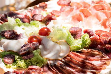 salame: reach of the kitchen of typical Italian cold cuts, pork: salciccia , prosciutto , salami Stock Photo