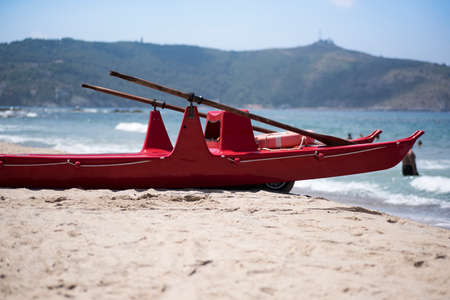 typical wooden rescue boat and rowing in the beaches of southern Italy