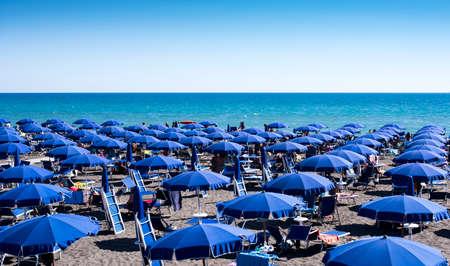 Beach full of umbrellas in the Mediterranean Sea in Italy