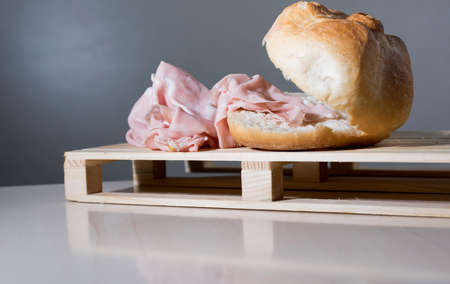 sandwich with mortadella, typical Italian food on the wooden support Stock Photo