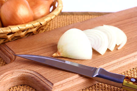 Onions on a cutting board. photo
