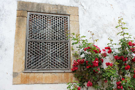 Original window of a house on the street of Obidos, Portugal  photo