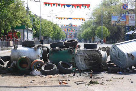barricades: MARIUPOL, UKRAINE - MAY 11, 2014  The barricades erected by the city s defenders against dramatic theater on Lenin Avenue   Editorial