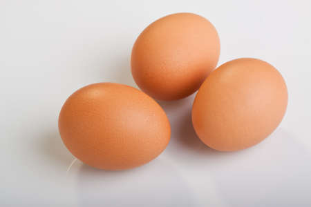 Three brown eggs on white background Stock Photo - 8567247