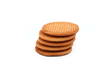 Five pieces of biscuits stacked pile on a white background Stock Photo