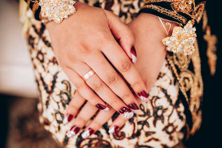 A Gold ring worn by the bride in a beautiful gown