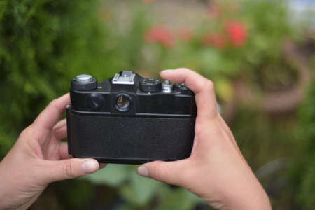 I hold the camera in my hands