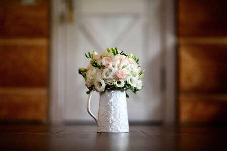 A bouquet of flowers on a mug