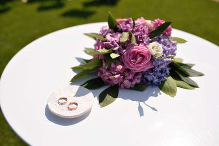 Bouquet of flowers on a white table Stock Photo