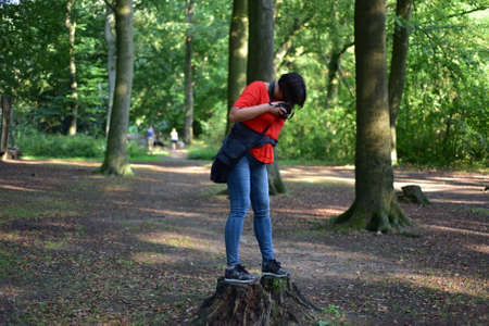 Woman takes pictures in the forest