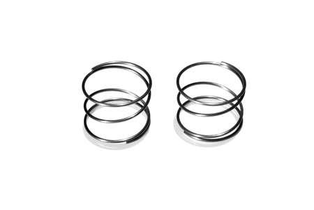 Close up of two small plated steel springs isolated on white background.