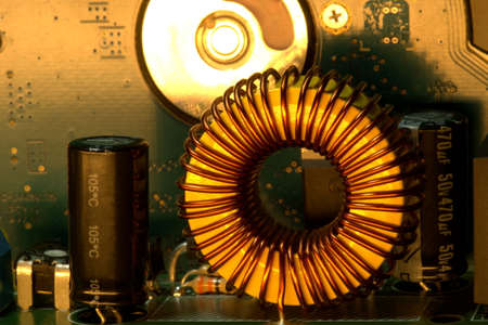 Induction coil and other details of electrical components on a circuit board.