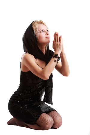 women praying: Image of a young women praying on white background Stock Photo