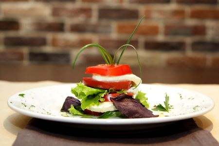 Image of a traditional italian caprese on plate photo