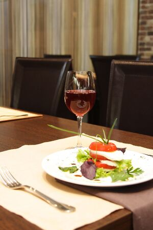 Photo of a traditional italian caprese on plate photo