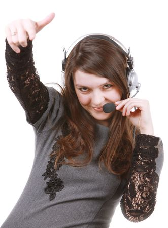 Image of a girl in headphones singing a song photo