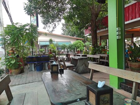 Authentic cafe on one of the quiet streets of Pattaya. Old wooden furniture, calm and comfort.