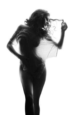 Naked brunette wearing wet t-shirt over white background Standard-Bild - 122592012