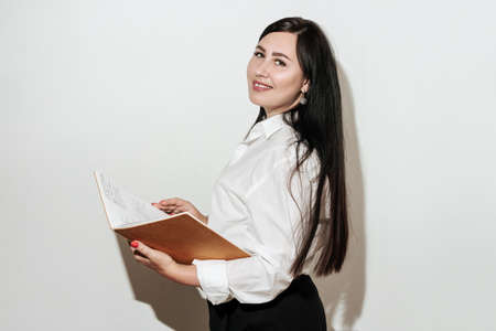 Pretty female over white. Businesswoman presentation