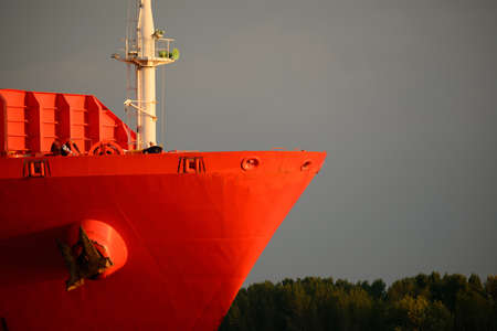 ship bow: Red lean bow of a container ship Stock Photo