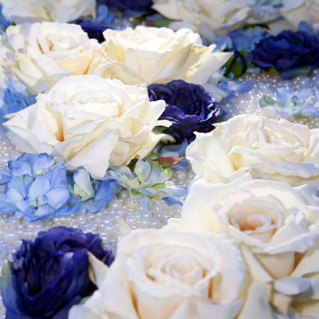blue roses: artificial white and blue roses on pearl beads Stock Photo