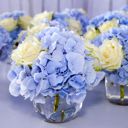 Bouquet Of White And Blue Flower In Vase Of Glass Decoration