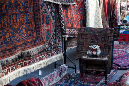 untidiness: London - January 17, 2015. Flea market with old-fashioned goods displayed in London city, UK. On 17 January 2015. Messy packed room full of antique objects like chair, glasses, carpet