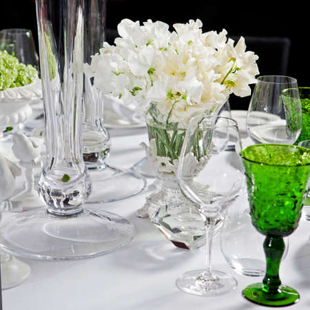 sweet pea: decoration of wedding table. bouquet of white flowers of sweet pea Stock Photo