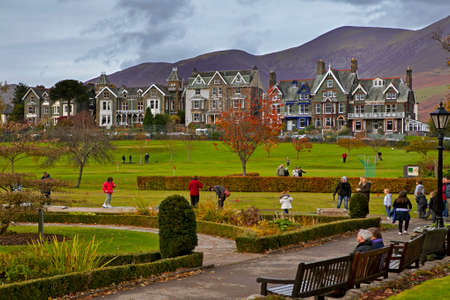KESWICK, UK - November  09, 2014: Tourists enjoy the scenic Lake District towns shops and cafes. Some of them  are playing golf Editorial