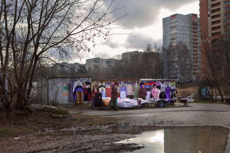 saleswomen: Moscow, RUSSIA - October 26, 2015: Street market. Two saleswomen sell clothes