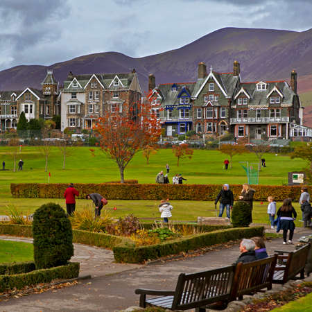 newlands: KESWICK, UK - November 09, 2014: Tourists enjoy the scenic Lake District towns shops and cafes. Some of them are playing golf