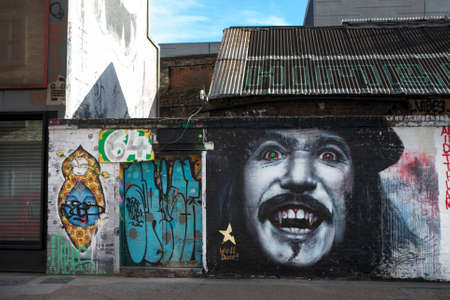 east end: LONDON, UNITED KINGDOM - JANUARY 12, 2014: Shoreditch, in the heart of the trendy East End of London, has become synonymous with the UK street art scene, attracting visitors from all over the world. Editorial