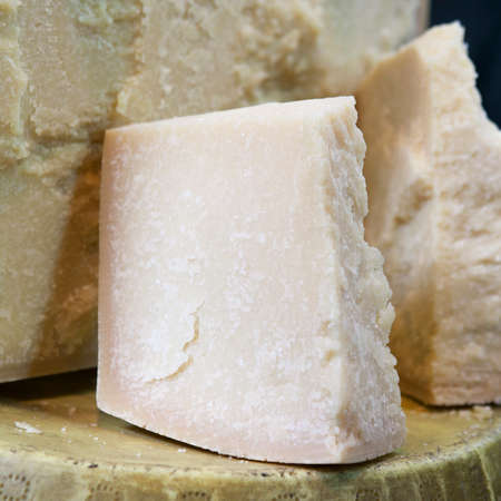 parmesan cheese: Gourmet Organic Parmesan Cheese on a Background
