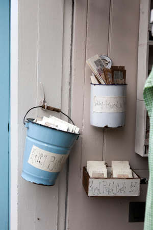 untidiness: London - January 17, 2015. Flea market with old-fashioned goods displayed in London city, UK. On 17 January 2015. Tin pails with old vintage postcards