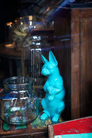 delftware: London - January 17, 2016. Showcases of vintage store with old-fashioned goods displayed in London city, UK. On 17 January 2016. Azure faience vintage dog