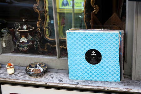flee: London - January 17, 2015. Flea market window shop with old-fashioned goods displayed in London city, UK, on 13 June 2014. Retro styled image of boxes with vinyl turntable records on a flee market