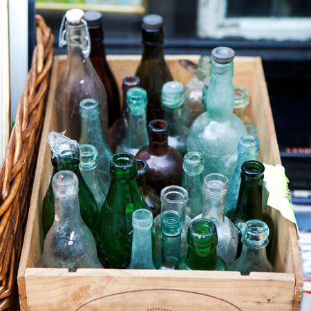 wood crate: Pastel Antique bottles in wood crate, London, UK