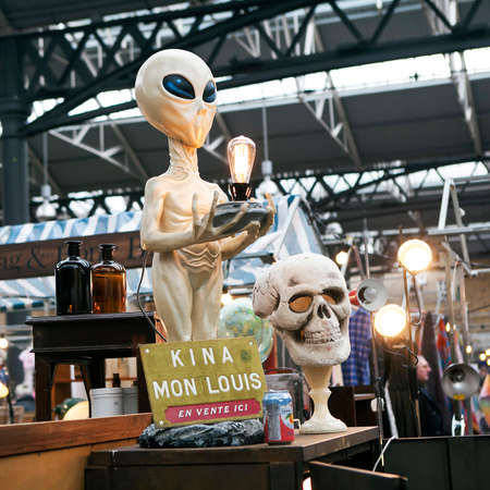 hamlets: LONDON, UK - APRIL 22, 2016: Lamp in the form of an alien at Spitalfields Market