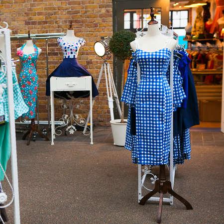 fleamarket: LONDON, UK - JULY 10: blue vintage dress in a check on a mannequin shop around Spitalfields Market on 10 July 2015