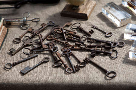decipher: Many old keys on a well used old canvas .