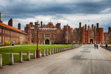 LONDON, UK - JUNE 4, 2013: View of Hampton Court Palace in London. Hampton Court was originally built for Cardinal Thomas Wolsey, a favorite of King Henry VIII, circa 1514.