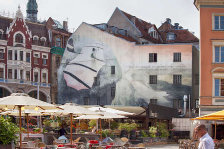 graffito: RIGA, LATVIA - JUNE 9, 2016: Street cafe in downtown of Riga