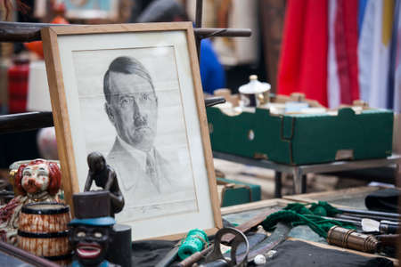 hamlets: LONDON-JUNE 27:Shoppers at Spitalfields Antic Market June 27,2016 in London. Market is fourth most popular attraction in city attracting over 100,000 people each weekend.  Portrait Hitler  for sell Editorial