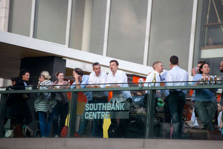 southbank: LONDON, UK - MAY 15 2016: People drinking beer outside the Southbank center. Editorial