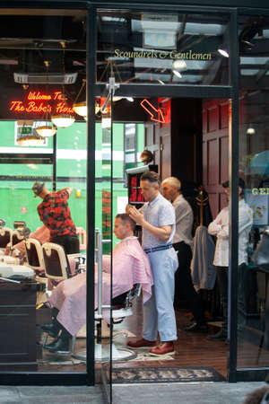 london to brighton: BRIGHTON, June 14, 2016: A famous old style barber shop in Spitalfields narket, London, United Kingdom.