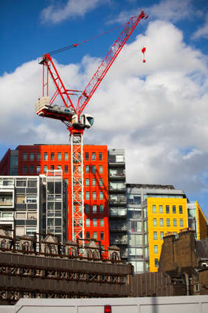 giles: LONDON, UK - JULY 25 2015: Bright-coloured facade of the modern Central Saint Giles mixed-use development in London, England.