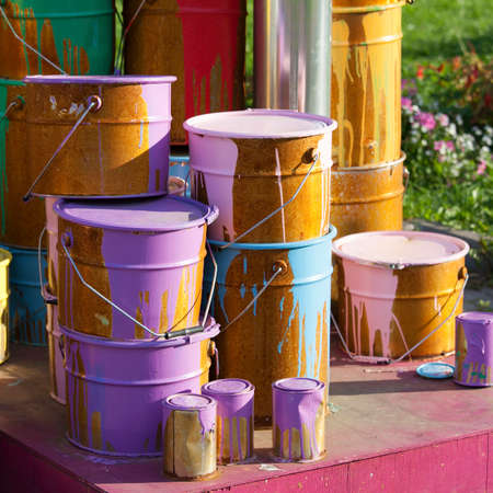 gallons: Paint cans on different colors