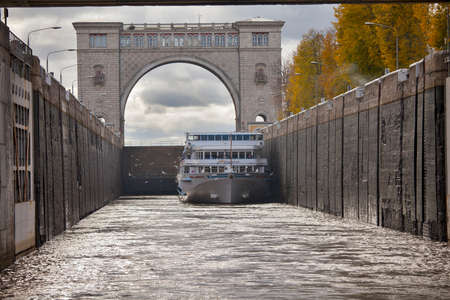 navigable: UGLICH, RUSSIA - JULY 19, 2016: Boat in navigable gateway of Uglich hydroelectric power station on river Volga, Uglich, Russia Editorial