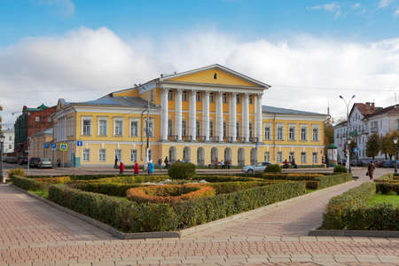 KOSTROMA, RUSSIA - September 20, 2016: Unidentified people walk on Susaninskaya square near house of General Borshchov, Kostroma, Russia Editorial