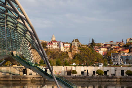city park boat house: TBILISI, GEORGIA, 16 AUGUST, 2016: The embankment of Kura River near the Rike Park and the President Palace above it Editorial